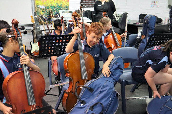 Students Investigate their new cellos